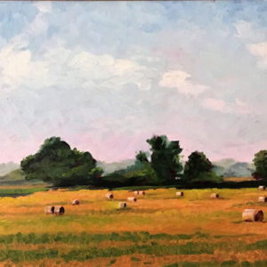 Bales of rolled hay under a beautiful painted sky in this plein air painting by Tom Smith